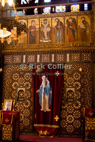 """Cairo, Egypt -- The Hanging Church (El Muallaqa) of St. Mary, is the most famous of Cairo's Christian churches.  It was built atop the sourther tower gate of the old Babylonian fortress in what is now Coptic Cairo and overhangs the original gate passage.  The interior of the church shows the unmistakable ornate decoration found in Coptic (Orthodox) churches. © Rick Collier / RickCollier.com.<br /> <br /> <br /> <br /> <br /> <br /> travel; vacation; tour; tourism; tourist; destination; Egypt; Cairo; gate; church; Copt; Coptic; """"Coptic Cairo""""; """"Hanging Church""""; decoration; decor; ornate"""