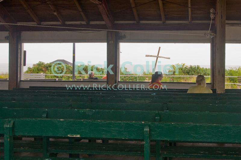 """Chapel"" - Ocean Grove, New Jersey, USA, was originally a Christian religious camp.  The beach still features crosses and an open-air chapel.<br /> <br /> <br /> .USA ""New Jersey"" NJ ""Ocean Grove"" Ocean Grove Christian camp chapel cross beach bather flower"