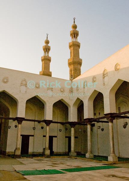 Mosque of Salih Tala'i, Cairo, Egypt.  This small mosque is one of the oldest in Islamic Cairo, standing just outside the old walled city, at the Bab Zwayla gate. © Rick Collier<br /> <br /> <br /> <br /> <br /> <br /> <br /> Egypt Egyptian Cairo tourist tourism history historic antiquities Islamic mosque 'old town' 'walled city' fan carpet beam pillar post window chandelier light arch worship religion Islam Muslim minaret 'Bab Zwayla' gate
