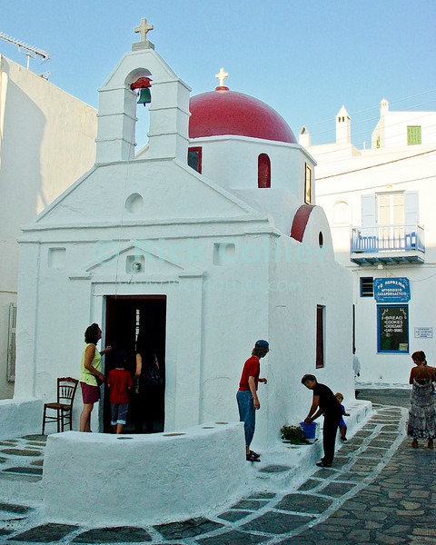 Mikonos, Greece.  A small local chapel is at the center of neighborhood life.  Not the stereotypical Greek Orthodox church, this one has a red dome.  © Rick Collier<br /> <br /> <br /> <br /> <br /> <br /> <br /> Greece Mikonos Mykonos Greek Orthodox church chapel