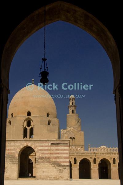 "Cairo, Egypt -- The unique spiral minaret stands behind the impressive fountain (sahn) at the center of the historic ibn Tulun mosque. © Rick Collier / RickCollier.com.<br /> <br /> <br /> <br /> <br /> <br /> travel; vacation; tour; tourism; tourist; destination; Egypt; Cairo; mosque; madrassa; Tulun; ""ibn Tulun""; fountain; sahn; minaret; ""spiral minaret"";"