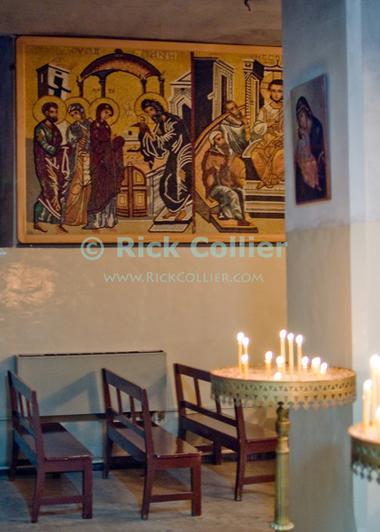 St. George's Orthodox Church in Madaba is the site of some of the most ornate and ancient mosaics and beautiful religious iconography in Jordan.  © Rick Collier<br /> <br /> <br /> <br /> <br /> Jordan Madaba church mosaic icon iconography painting Christian 'Saint George' 'St. George' 'St. George Church' 'St. George Orthodox Church' Greek Orthodox chandelier mosaic mosaics history historic tourist tourism candle candles