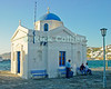 Mikonos, Greece.  Local fishermen rest in the shade of the small Greek Orthodox church at the harbor.  © Rick Collier<br /> <br /> <br /> <br /> <br /> <br /> <br /> Greece Mikonos Mykonos Greek Orthodox church chapel harbor