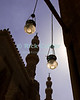 "Cairo, Egypt -- Lamps and minarets silhouetted against the clear blue sky at the Sultan Hassan mosque.   © Rick Collier / RickCollier.com<br /> <br /> <br /> <br /> travel; vacation; tour; tourism; tourist; destination; Egypt; Cairo; mosque; madrassa; Sultan; Hassan; ""Sultan Hassan""; lamp; lamps; spire; minaret; minarette; sky; silhouette;"