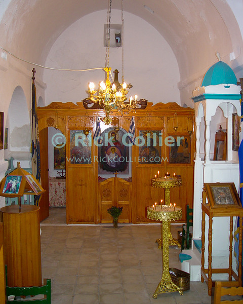Mikonos, Greece.  The simple interior of a small local Greek Orthodox church.  © Rick Collier<br /> <br /> <br /> <br /> <br /> <br /> <br /> Greece Mikonos Mykonos tour tourist tourism small Greek Orthodox church chapel altar icon icons interior