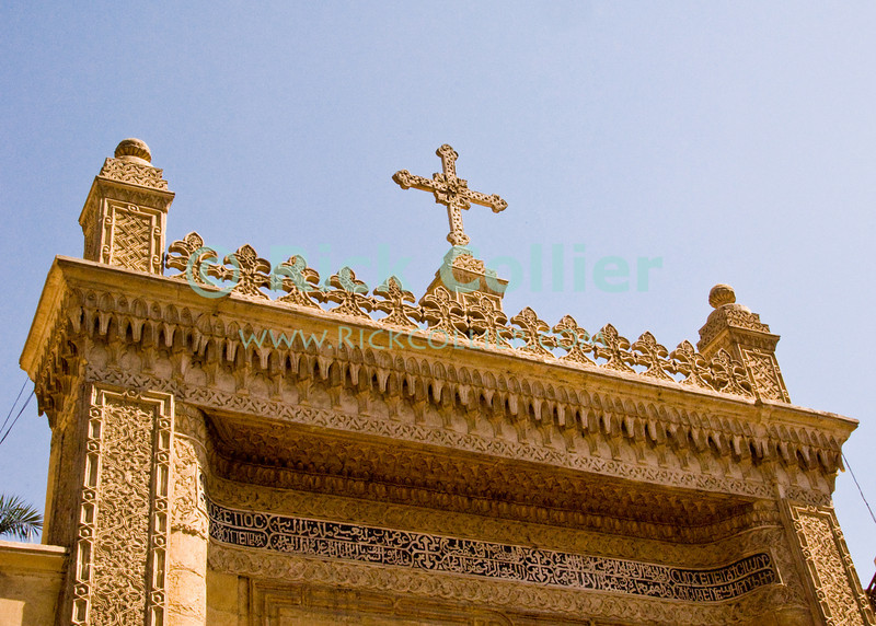 "Cairo, Egypt -- The Hanging Church (El Muallaqa) of St. Mary, is the most famous of Cairo's Christian churches.  It was built atop the sourther tower gate of the old Babylonian fortress in what is now Coptic Cairo and overhangs the original gate passage.   © Rick Collier / RickCollier.com.<br /> <br /> <br /> <br /> <br /> <br /> travel; vacation; tour; tourism; tourist; destination; Egypt; Cairo; gate; church; Copt; Coptic; ""Coptic Cairo""; ""Hanging Church"""