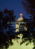 The cross at the top of St. George's Orthodox Church lights up an evening sky in Madaba, Jordan.  © Rick Collier<br /> <br /> <br /> <br /> <br /> Jordan Madaba church mosaic icon iconography painting Christian 'Saint George' 'St. George' 'St. George Church' 'St. George Orthodox Church' Greek Orthodox cross iconic night lights belfry