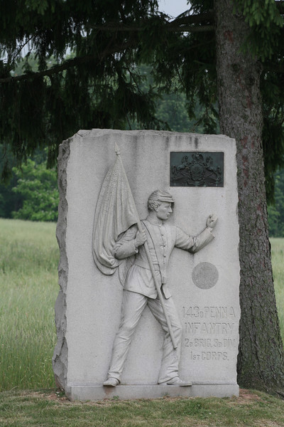 143rd Pennsylvania - its flagbearer angrily shook his fist at the approaching Rebels before being cut down by bullets.