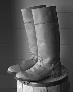 A black and white photo of the boots in the Greteman Brothers General Store in Walnut Hill at Living History Farms