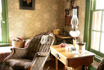 This is a photo of the family parlor at the Tangen house at Living History Farms