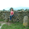 Carole on stone stile, which lets you over the wall into the Castlerigg field from the public footpath.