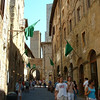 One of the main streets and a couple of the towers of San Gimignano