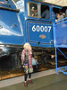 pic by Ghost Station Man <br /> <br /> Liz poses under the Number / cab of Sir Nigel Gresley which she <br /> <br /> see's quite regularly on it's trips to and from the NYMR she was <br /> <br /> made up to finally it up closer and personal instead of just seeing <br /> <br /> from the Platform at Gypsy Lane