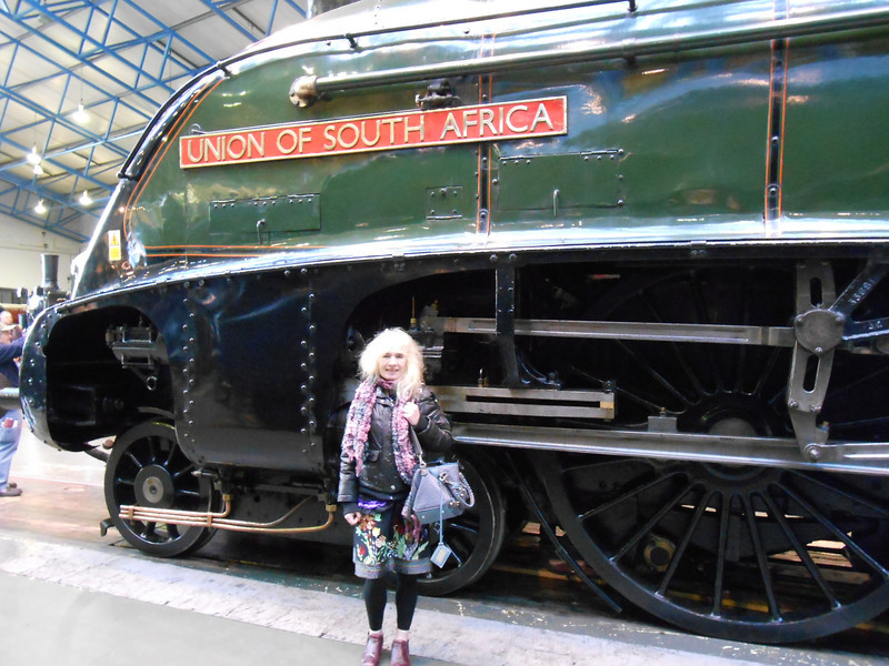 Pic by Ghost Station Man <br /> <br /> Liz poses under Union of South Africa name plate