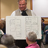 Actor Joseph Zamparelli, as Lizzie Borden's defense atorney George Dexter Robinson, shows the layout of the Borden house to members of the audience during a performance at Leominster Library. SENTINEL&ENTERPRISE/ Jim Marabello
