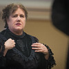 Lizzie Borden played by Lynne Moulton answers questions under path during a performance at Leominster Library. SENTINEL&ENTERPRISE/ Jim Marabello