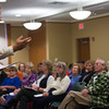 Actor Joseph Zamparelli, as defense atorney George Dexter Robinson explains Lizzie Borden's innocence to the audience during a performance at Leominster Library. SENTINEL&ENTERPRISE/ Jim Marabello