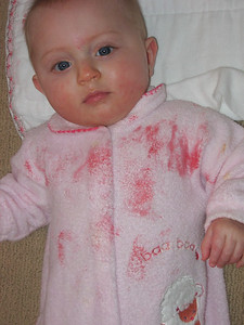 This is what happens when you give a baby a strawberry and then forget to watch her!
