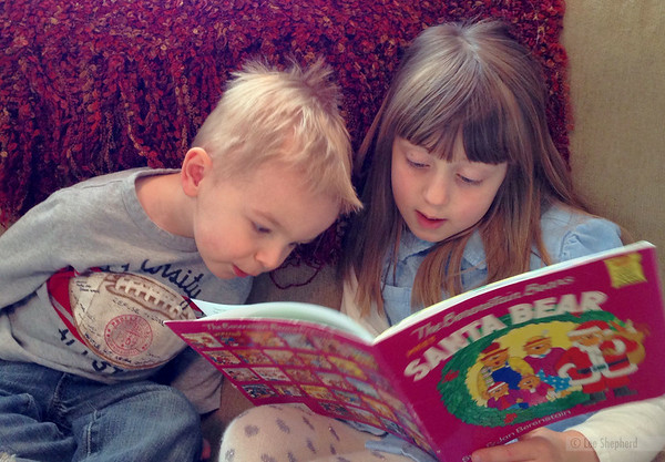 Reading to her buddy Jake