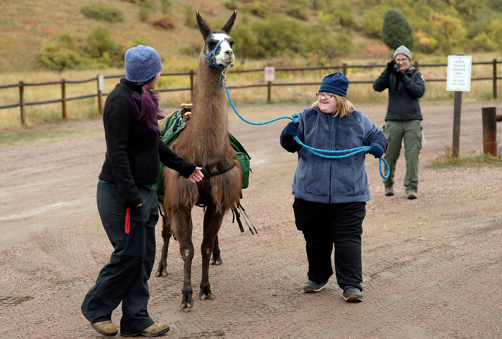 . BOULDER, CO - OCTOBER 9, 2018: Pack Animal Magazine Editor Alexa Metrick, left, helps Kaela May walk with a llama on Tuesday at the Doudy Draw Trailhead in Boulder County. Boulder\'s Open Space and Mountain Parks, The Center for People with Disabilities, and Pack Animal Magazine teamed together to try to find a way to use the llamas to help people with disabilities access the backcountry trails. For more photos and video of the event go to dailycamera.com (Photo by Jeremy Papasso/Staff Photographer)