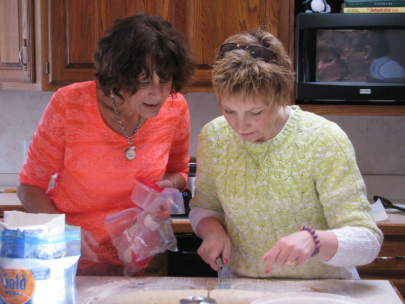 Toni Sultzer & Cathy Pastron slicing the rolls