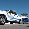 The Holmes Beach Police Department is Protecting Paradise and pulling a St. Patricks Day parade boat along Palm Drive in Holmes Beach, FL