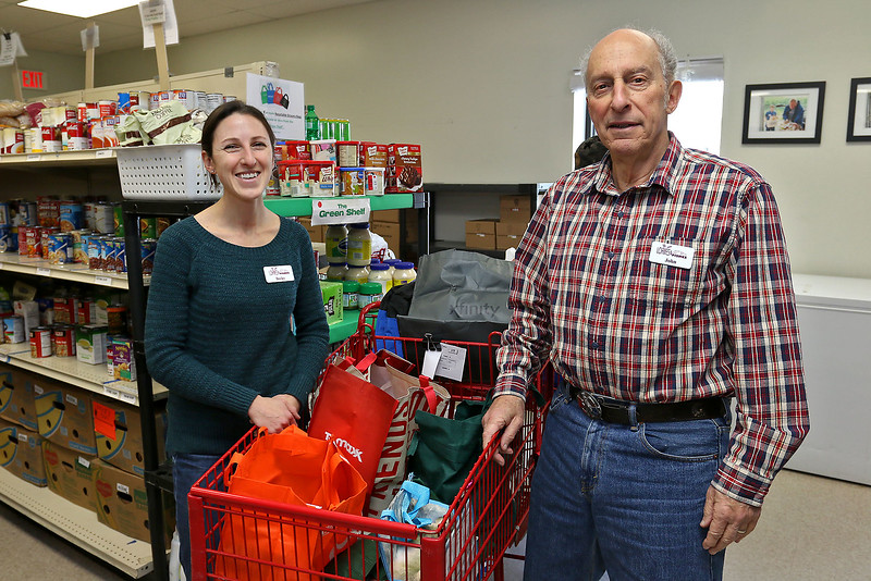 Loaves and Fishes Food Pantry volunteers Becky Zolla from Littleton and and John Costello from Harvard. SUN/JOHN LOVE