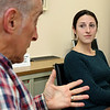 Becky Zolla listens to John Costello as they both talked about being a volunteer at Loaves and Fishes Food Pantry on Devens. SUN/JOHN LOVE