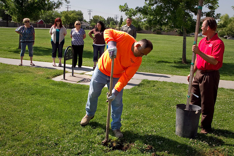 "Planting the ""Tree of Hope"" in the park.  The tree was donated by Sunset Waste."