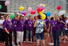 Each survivor was given a balloon to carry with them around the first lap of the track.  On the balloons they wrote thier name and how long they are a survivor of cancer.  After the first lap they all congregated again and waited for all walkers to met at the starting point.