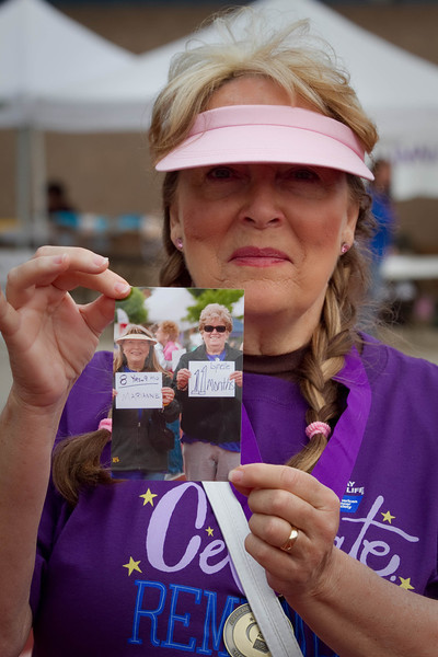Marianne Phillps a 9 years survivor walks with a picture of her friend Lynelle who is currently fighting Kidney cancer, but could not attend the event.  The picture is of last years walk where the two walked together.