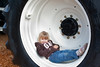 Cutest thing ever....she posed in the wheel well of a monster tracter.