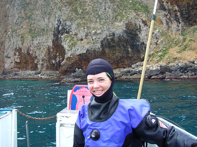 "Stacey, aka ""neoprene head,"" all geared up and ready to dive"