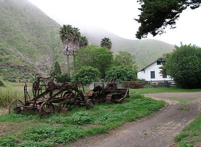 Old ranch house and farm equipment