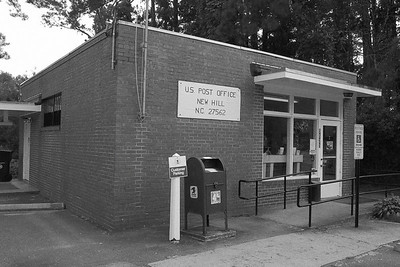 The tiny New Hill Post Office remains in business