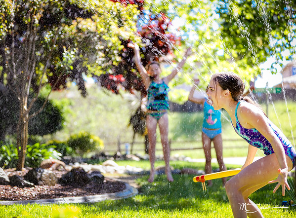 Sprinklers, water balloons, a wiffle ball bat rigged with spikes (duct taped golf tees), and 3 crazy girls.  What could go wrong?
