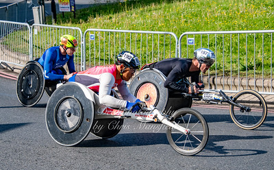 American Daniel Romanchuk ( in blue,  on left )  was the winner of the mens wheelchair race