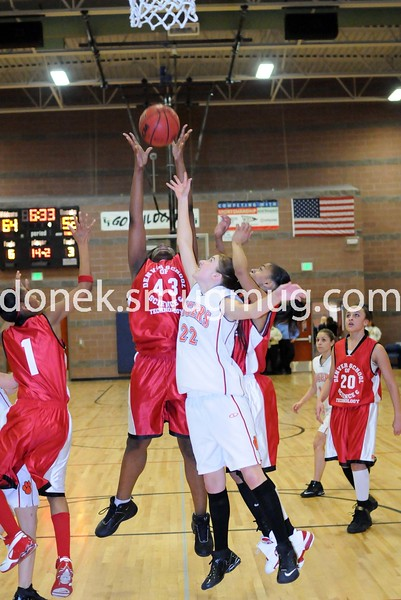 Krista Lopez jumps for the rebound