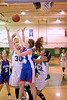 Shasta L'Heureux battles for the rebound with Calhan's Brittany Ackerman