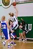 Shelby Turecek jumps high to take a shot.
