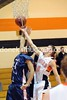 Kenny Weikel and Huskie Trie Dysart reach for the rebound