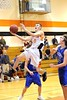 Kenny Weikel walks on air on his way to the basket