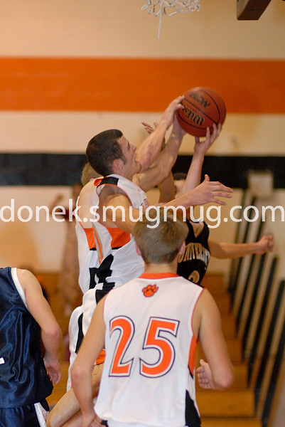 Kenny Weikel and Steven Ronin battle with Zach Romero for the rebound