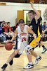 Justin Gallagher drives the ball past Christian Schimpf