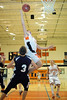 Tyler Laducer knocks over Justin Hoffman on his way to the net