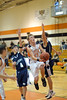 Tim Keller gets past a couple of Wildcats to make a shot