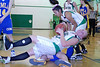Shasta L'Heureux Takes a fall after being fouled.