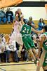 Brian Martinez takes a shot and Ben Lloyd tries to block him.