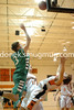 Travis Adamson knocks over Tyler Laducer on his way to the basket.