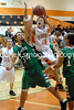 Kasey Martin tries to block a shot from Tyler Laducer